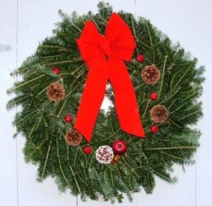 Wreath traditionally decorated with red bow